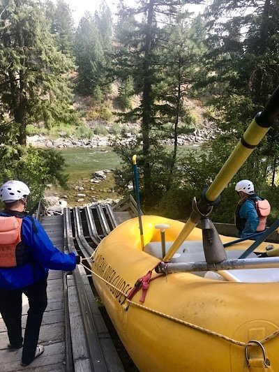 launching raft into Clark Fork River