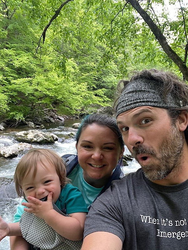 family by a stream in Great Smoky Mountains National Park